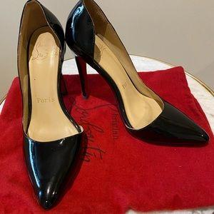 Black Louboutin high heel shoes